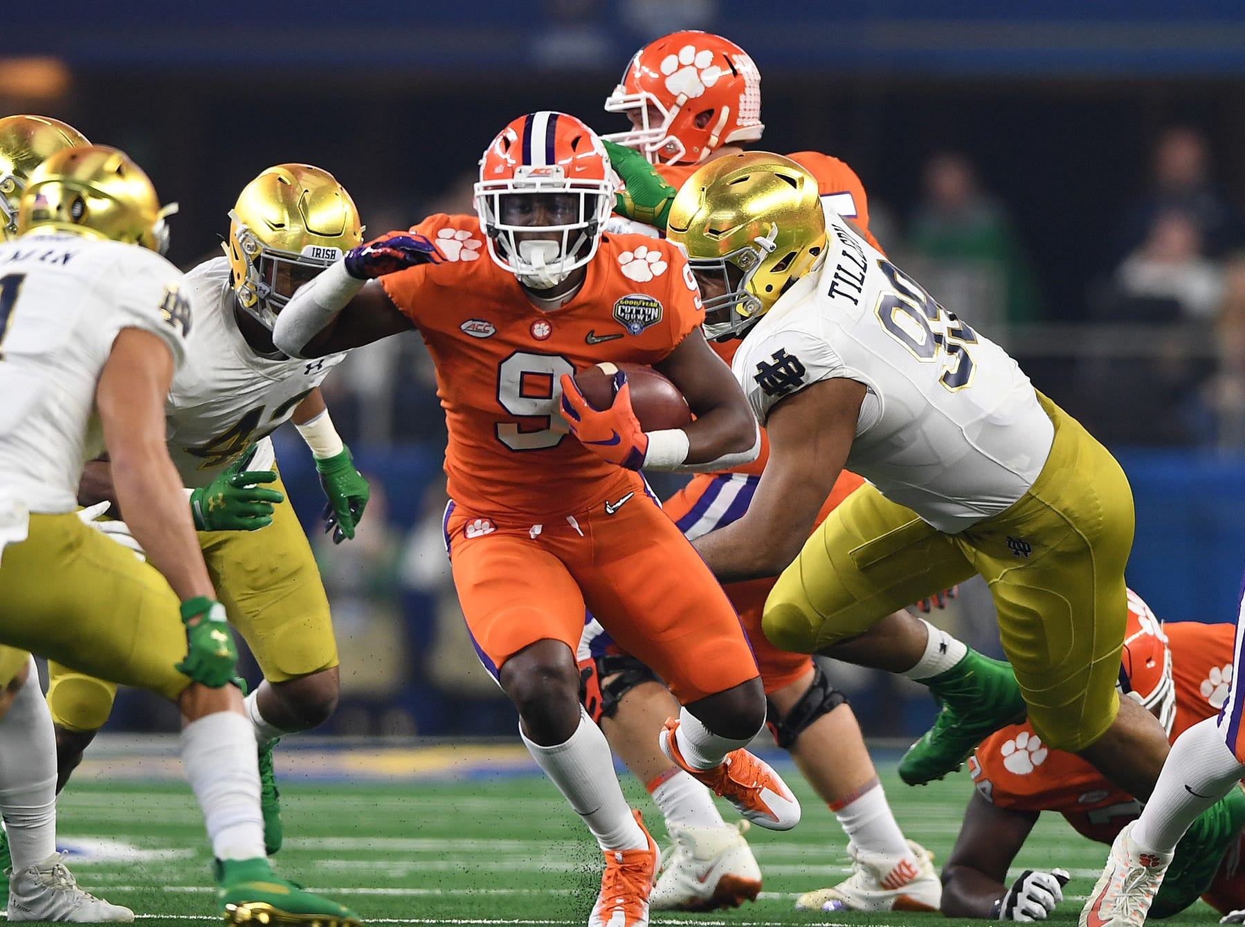 Clemson running back Travis Etienne (9) carries against Notre Dame during the 1st quarter of the Goodyear Cotton Bowl at AT&T stadium in Arlington, TX Saturday, December 29, 2018.