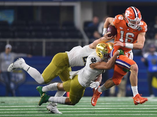 Clemson quarterback Trevor Lawrence (16) carries against Notre Dame during the 2nd quarter of the Goodyear Cotton Bowl at AT&T stadium in Arlington, TX Saturday, December 29, 2018.