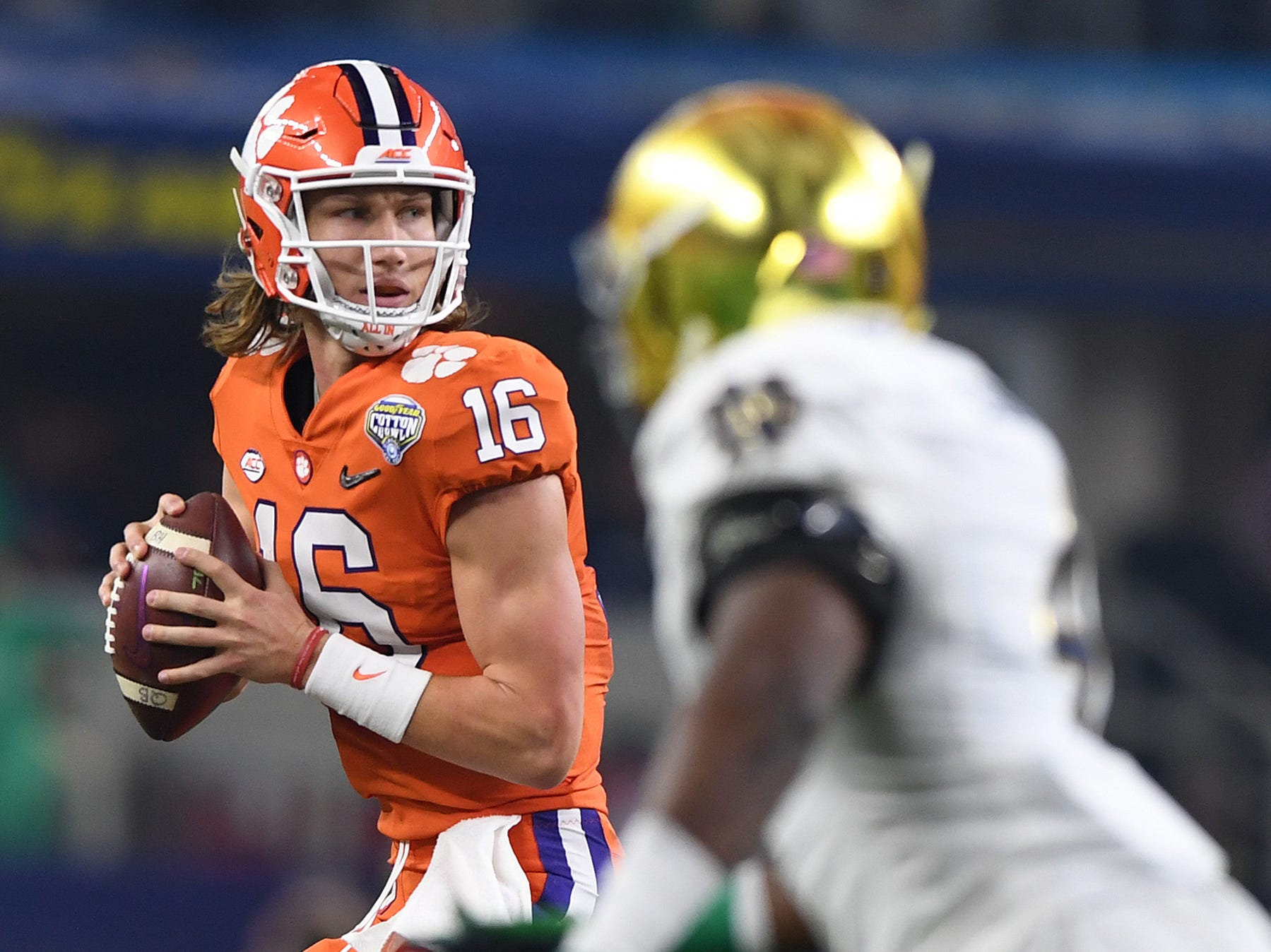 Clemson quarterback Trevor Lawrence (16) looks to pass against Notre Dame during the Goodyear Cotton Bowl.