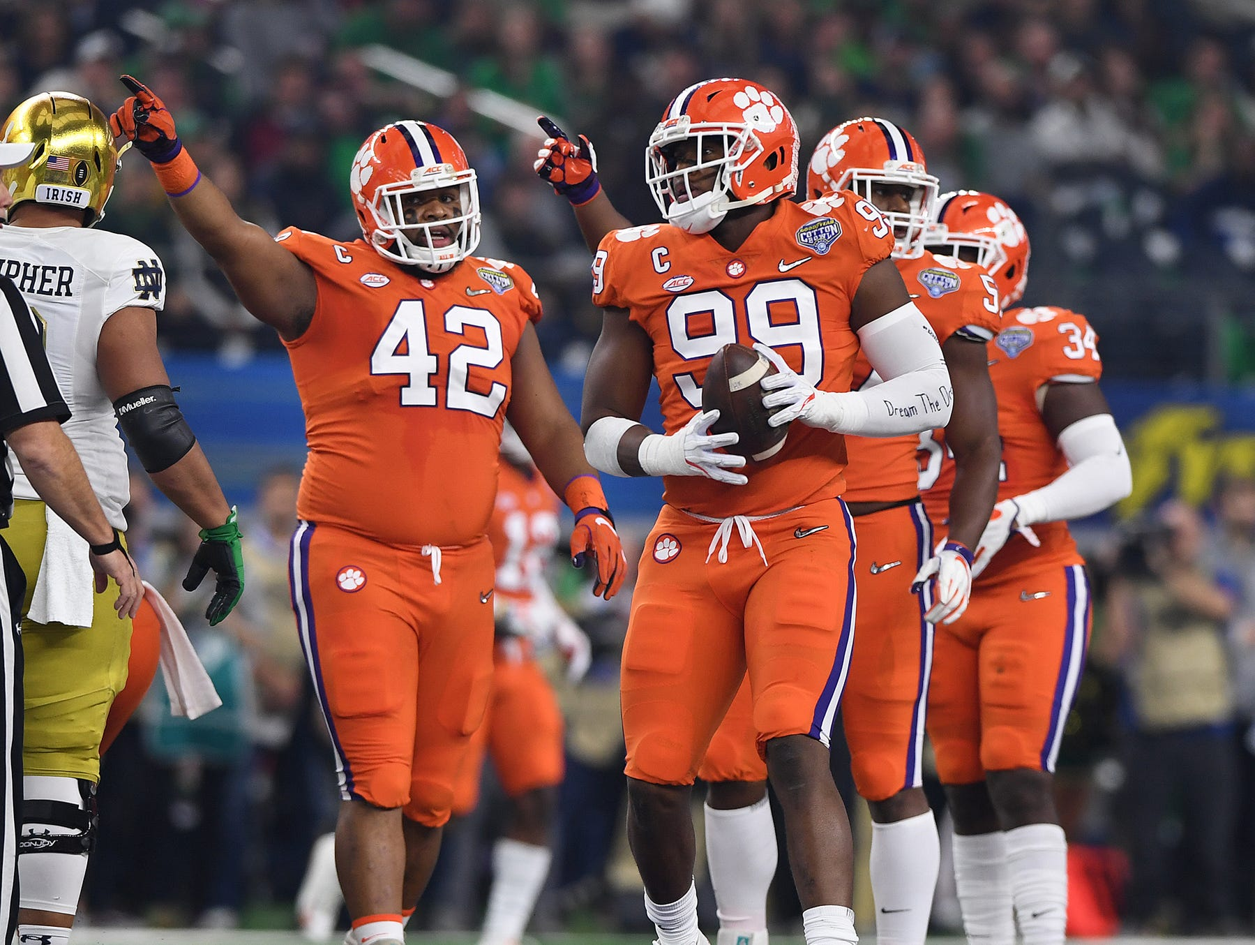 Clemson defensive lineman Clelin Ferrell (99) recovers a fumble by Notre Dame quarterback Ian Book (12) during the 1st quarter of the Goodyear Cotton Bowl at AT&T stadium in Arlington, TX Saturday, December 29, 2018.