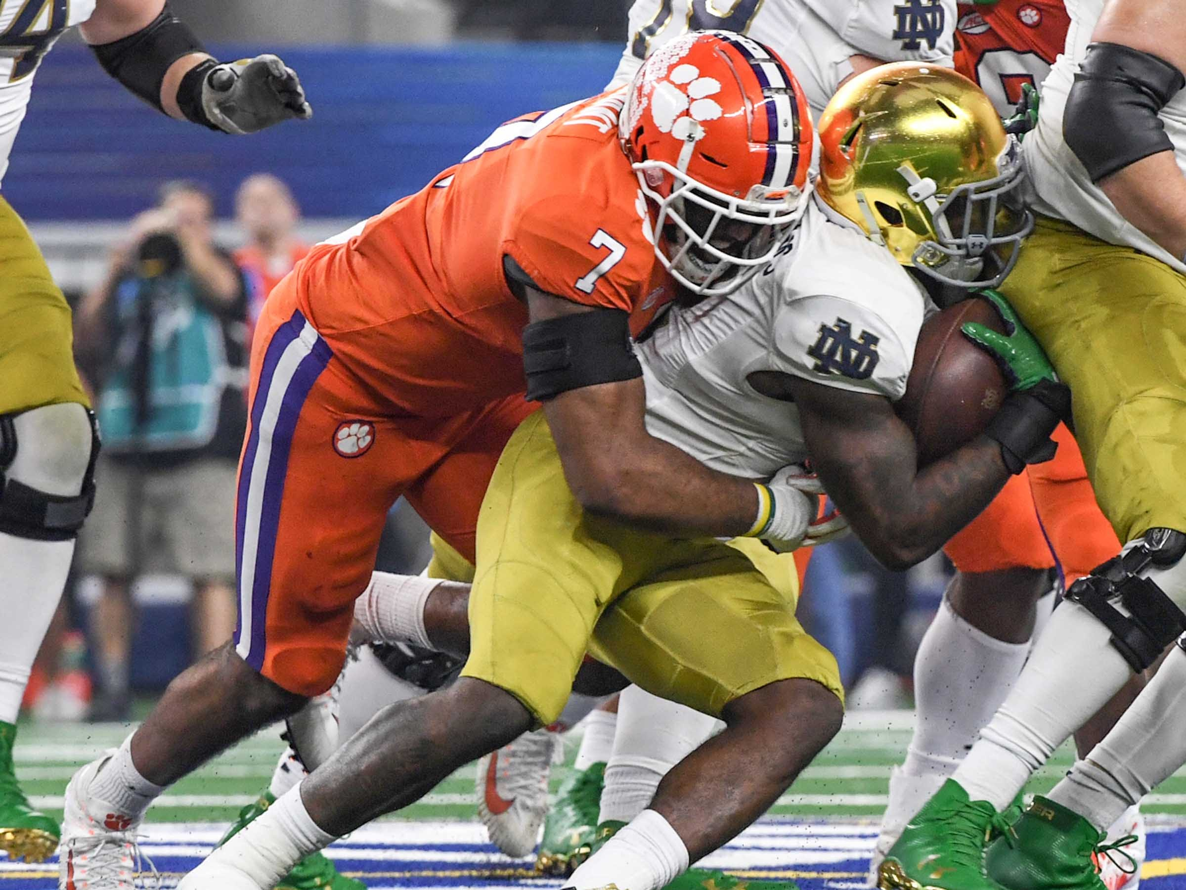 Clemson defensive lineman Austin Bryant (7) tackles Notre Dame running back Dexter Williams (2) during the College Football Playoff Semifinal at the Goodyear Cotton Bowl Classic at AT&T Stadium in Arlington, Texas Saturday.