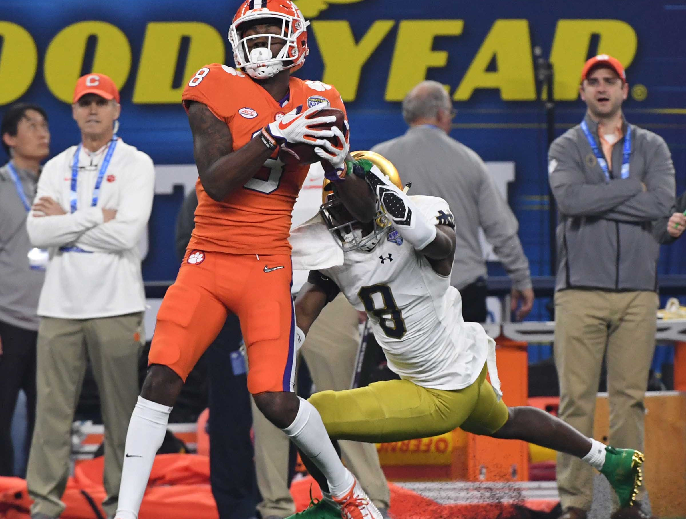 Clemson wide receiver Justyn Ross (8) catches a ball near Notre Dame cornerback Donte Vaughn (8) for a 52-yard touchdown during the first quarter of the College Football Playoff Semifinal at the Goodyear Cotton Bowl Classic at AT&T Stadium in Arlington, Texas Saturday, December 29, 2018.