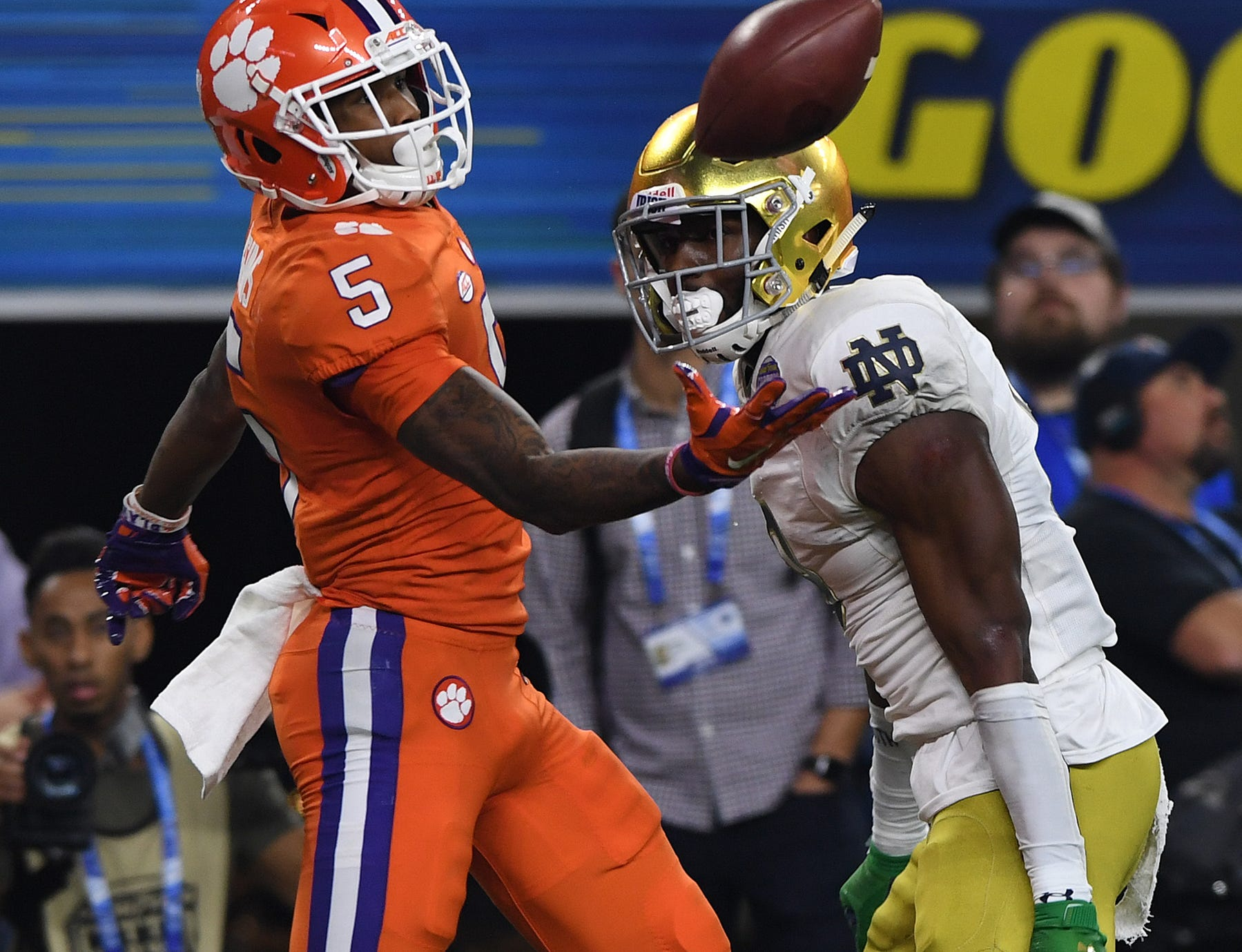 Clemson wide receiver Tee Higgins (5) pulls in a 19 yard TD past Notre Dame cornerback Donte Vaughn (8) with 2 seconds left to play in the 2nd quarter of the Goodyear Cotton Bowl at AT&T stadium in Arlington, Texas on Saturday.