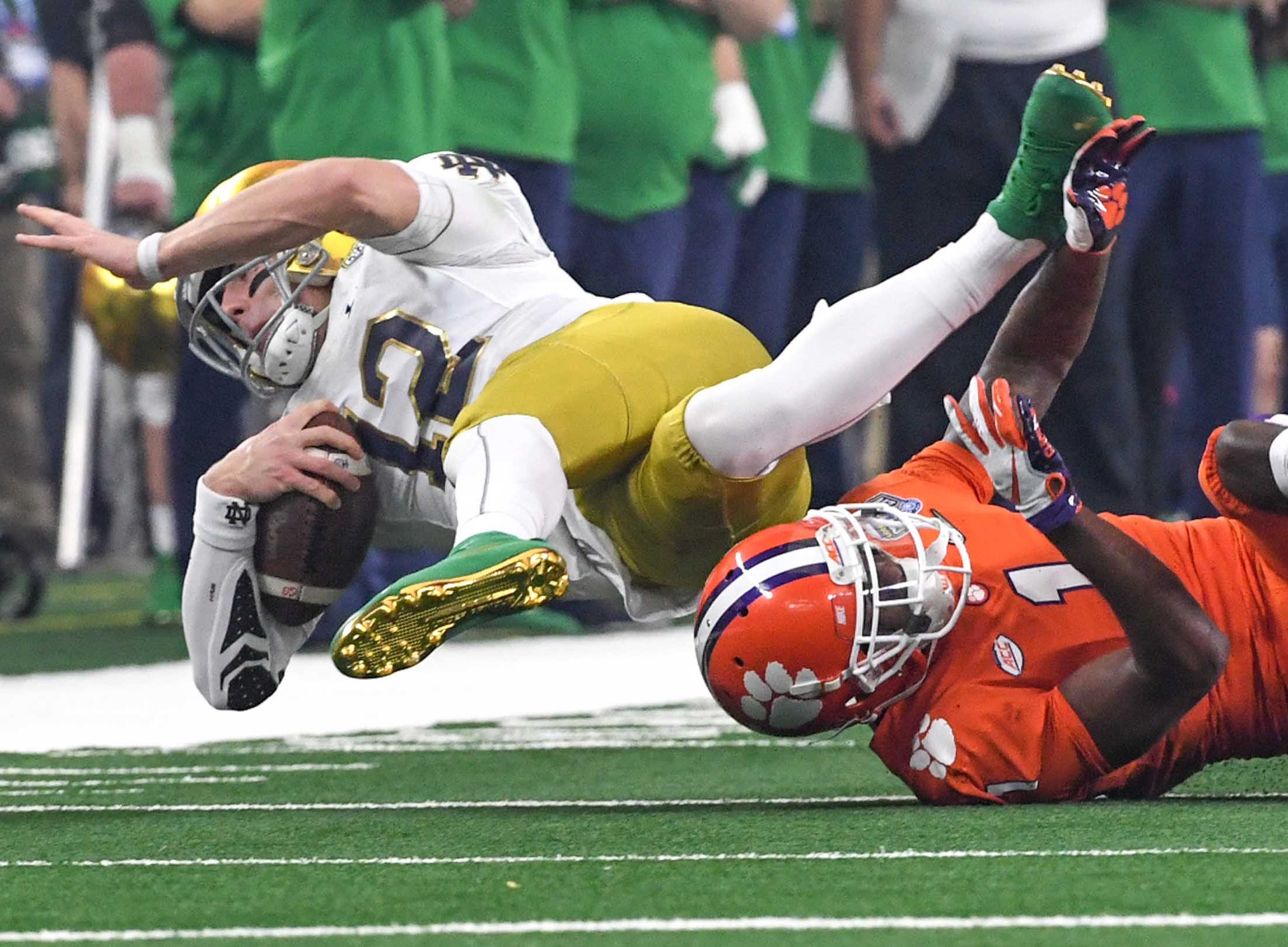 Clemson cornerback Trayvon Mullen (1) tackles Notre Dame quarterback Ian Book (12) during the first quarter of the College Football Playoff Semifinal at the Goodyear Cotton Bowl Classic at AT&T Stadium in Arlington, Texas Saturday, December 29, 2018.