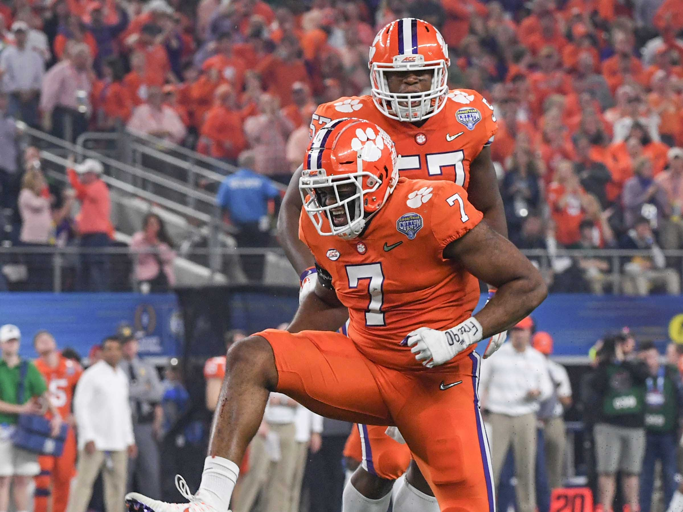 Clemson defensive lineman Austin Bryant (7) celebrates after tackling Notre Dame running back Dexter Williams (2) for a loss during the College Football Playoff Semifinal at the Goodyear Cotton Bowl Classic at AT&T Stadium in Arlington, Texas Saturday.