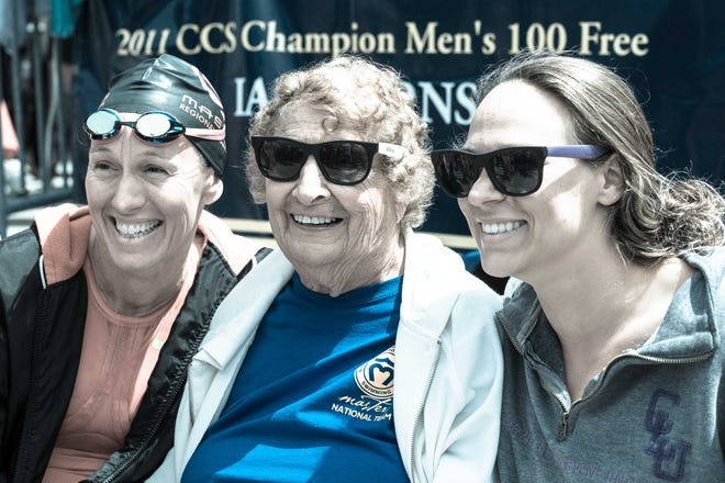 Great Falls native Maureen Kornfield, center, smiles with her California friends Cheryl, left, and Shannon at a swimming competition in 2014.