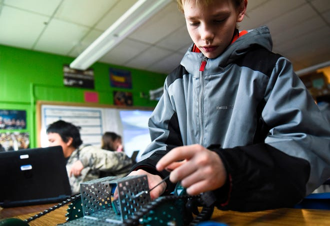 Sixth-grader Exzavior Allison works on a project in a classroom at Riverside Middle School in Billings, Mont., on Thursday, Dec. 20, 2018. Riverside has rolled out a new academic program aimed at getting students more targeted help this school year, and leaders are optimistic that it will move the needle on academic achievement. (Matt Welch/The Billings Gazette via AP)