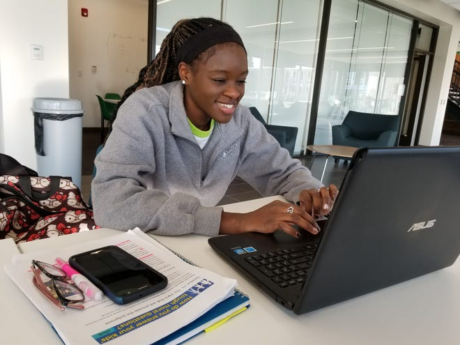 University of Providence senior Tranell Blazio works on the budget she built with her husband as part of United Way's Financial Futures Program.