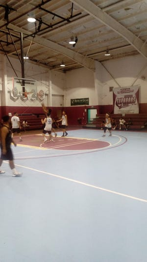 Fish and Kon go head to head with ASC during the annual Holiday TipOff tournament at the Tamuning Gym on Dec. 28, 2018.