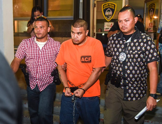 Brandon Michael Acosta, 24, is escorted by Guam Police Department criminal investigations division officers from the GPD Hagåtña Precinct to an awaiting vehicle after his arrest on Friday, Oct. 19, 2018. Acosta was charged in connection with the June 16 homicide of 15-year-old Dededo teen, Timicca Nauta.