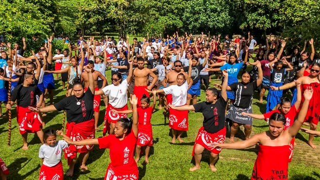 Cultural dancers representing various Chamoru gumas, or dance houses, performed alongside each other during the Dinanna Pa'a Taotao Tano, an annual event at the Valley of the Latte Adventure Park in Talofofo on Friday, June 29, 2018.