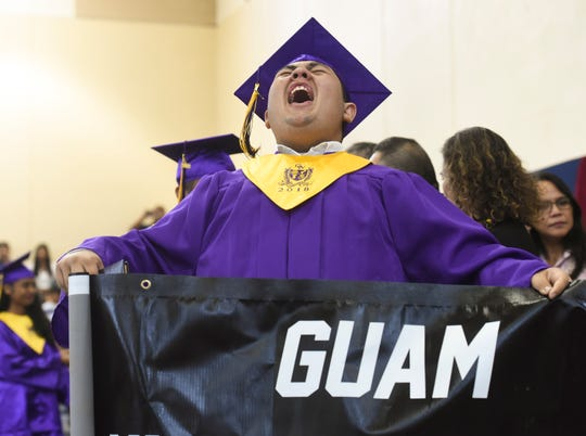 A George Washington High School graduate expresses his emotions during the Guam Department of Education Rainbow Graduation 2018 at the Okkodo High School Gymnasium, July 27, 2018.