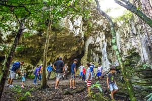 Trekkers gather at the entrance of the Star Cave during a walking tour at the Guam National Wildlife Refuge, Puntan Litekyan (Ritidian Point Unit) in Yigo on Saturday, Feb. 17, 2018. The cave tour was one of the activities offered as part of Archaeology Day celebrated at the refuge.