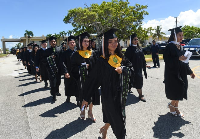 Triton graduates head to the University of Guam Calvo Field House for their spring commencement ceremony on May 20, 2018.
