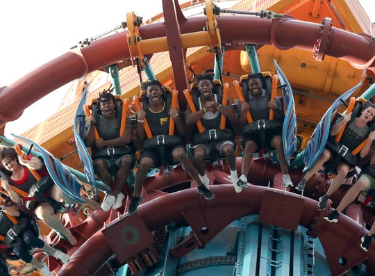 Iowa Hawkeyes defensive back Devonte Young (from left), wide receiver Brandon Smith, wide receiver Ihmir Smith-Marsette and and running backs coach Derrick Foster ride Falcon's Fury on Saturday at Busch Gardens. Smith was particularly scared, Smith-Marsette was happy to report afterward.