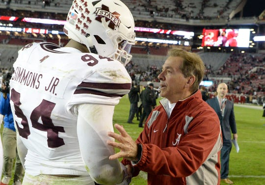 Mississippi State defensive tackle Jeffery Simmons (94) is shown next to Alabama coach Nick Saban following their game in November. Simmons is turning pro after the Outback Bowl.