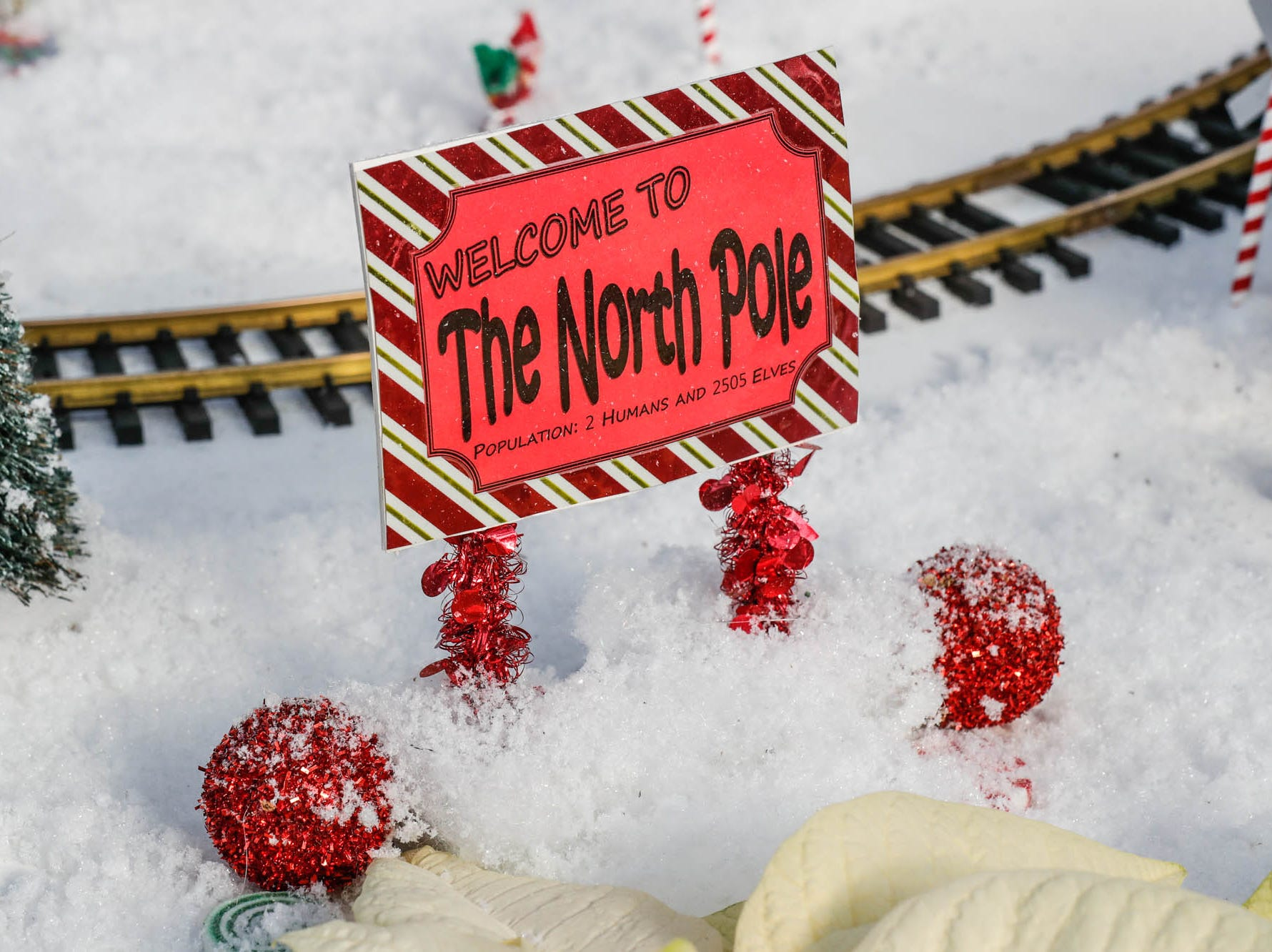 A sign welcomes guests to the North Pole in the Conservatory Crossing holiday display at the Garfield Park Conservatory on Saturday, Dec. 29, 2018.