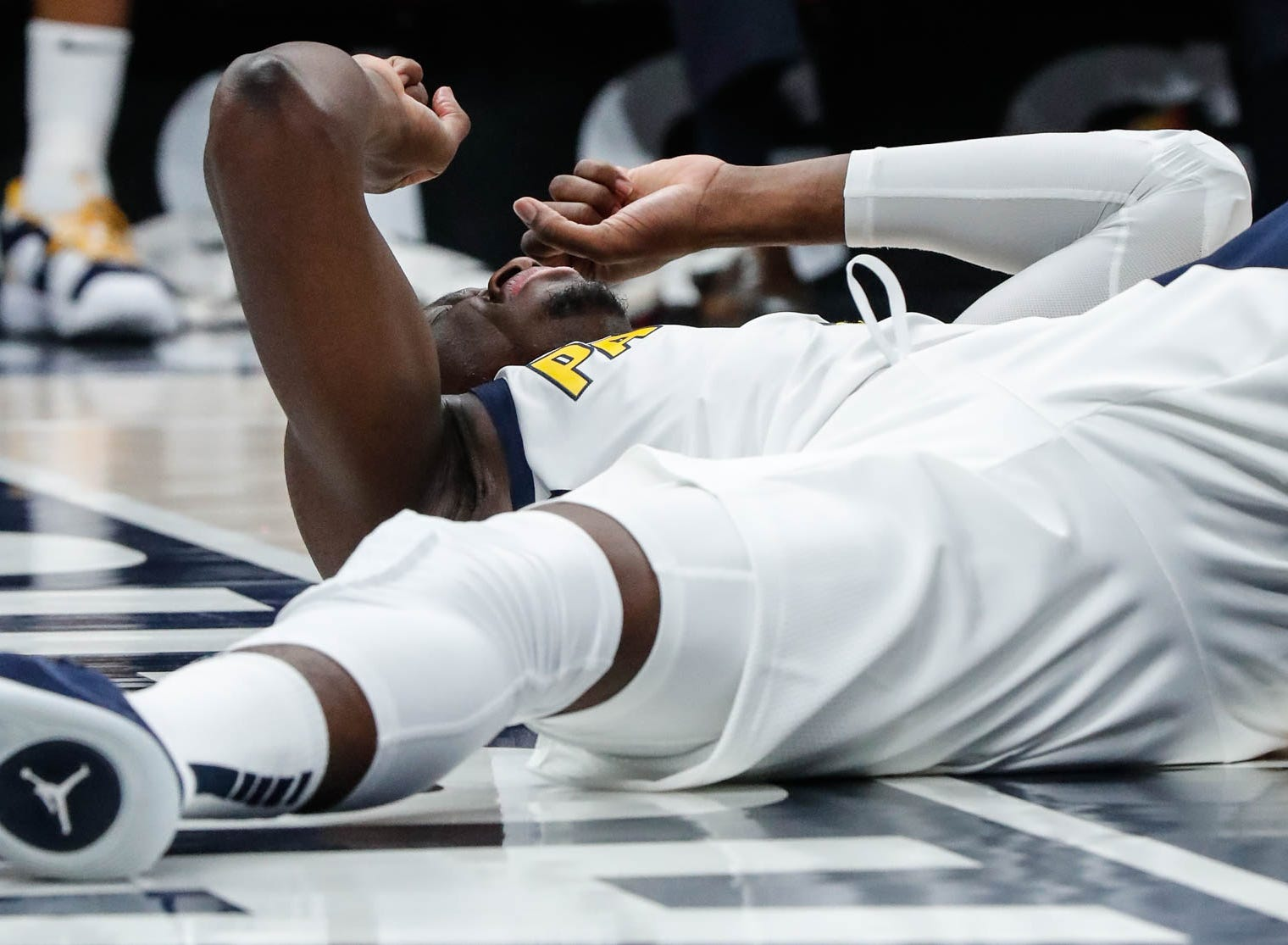 Indiana Pacer's guard Victor Oladipo (4) hits the ground after a play during a game between the Indiana Pacers and the Detroit Pistons at at Bankers Life Fieldhouse in Indianapolis on Friday, Dec. 28, 2018.