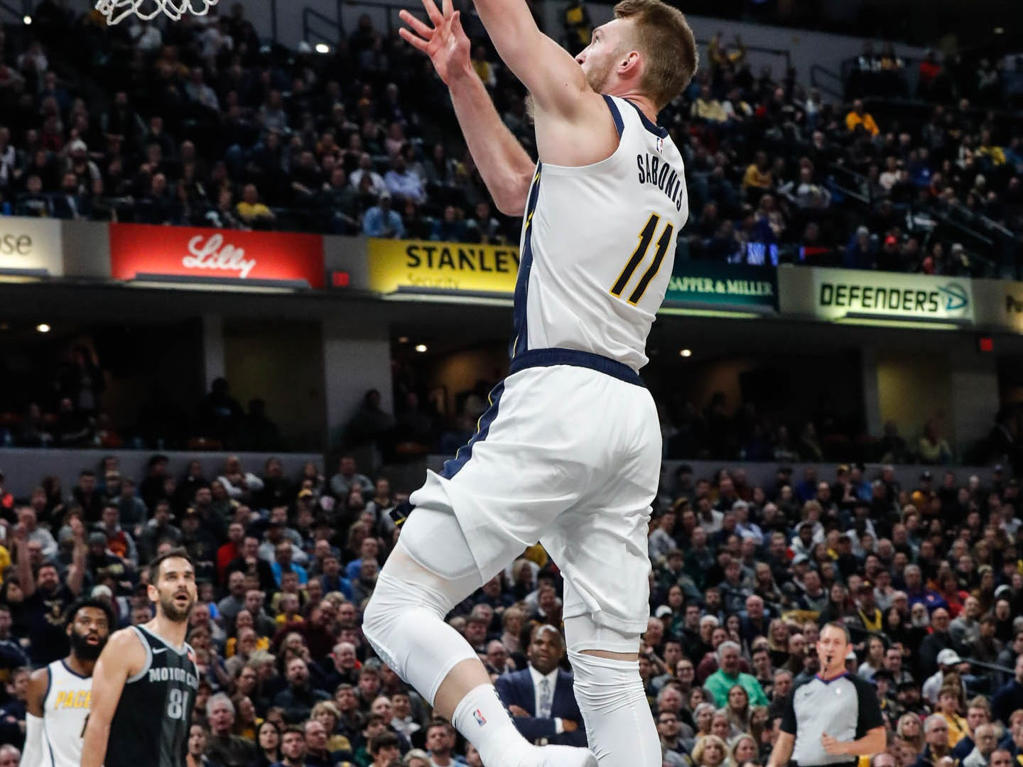 Indiana Pacer's forward Domantas Sabonis (11) hits a big dunk during a game between the Indiana Pacers and the Detroit Pistons at at Bankers Life Fieldhouse in Indianapolis on Friday, Dec. 28, 2018.