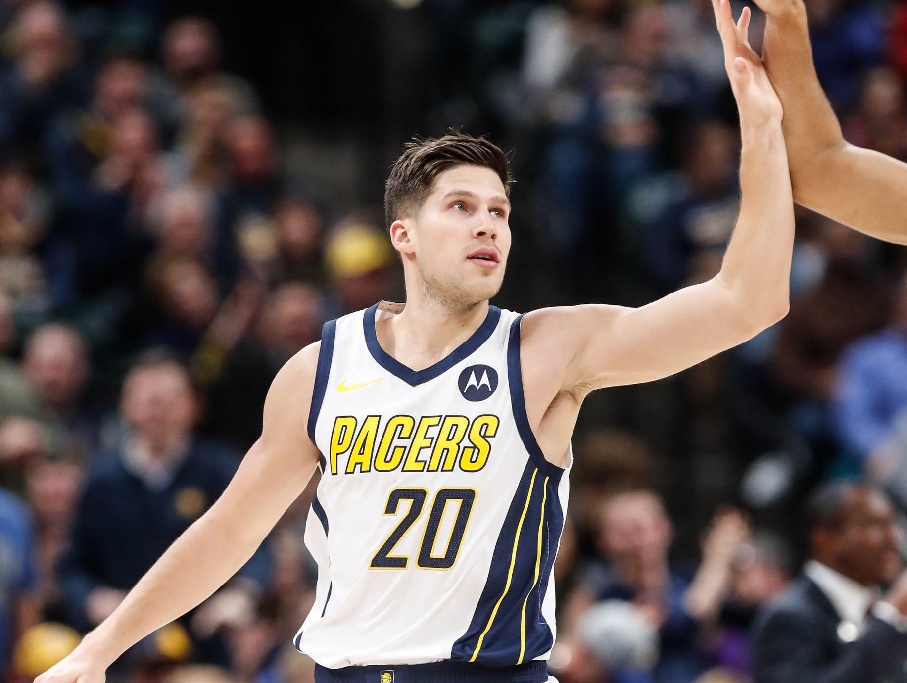 Indiana Pacer's forward Doug McDermott (20) is high five'd by a team mate after his dunk during a game between the Indiana Pacers and the Detroit Pistons at at Bankers Life Fieldhouse in Indianapolis on Friday, Dec. 28, 2018.
