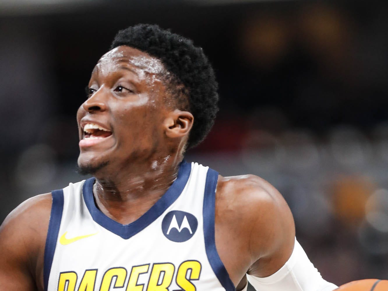 Indiana Pacer's guard Victor Oladipo (4) drives past another player to the hoop during a game between the Indiana Pacers and the Detroit Pistons at at Bankers Life Fieldhouse in Indianapolis on Friday, Dec. 28, 2018.