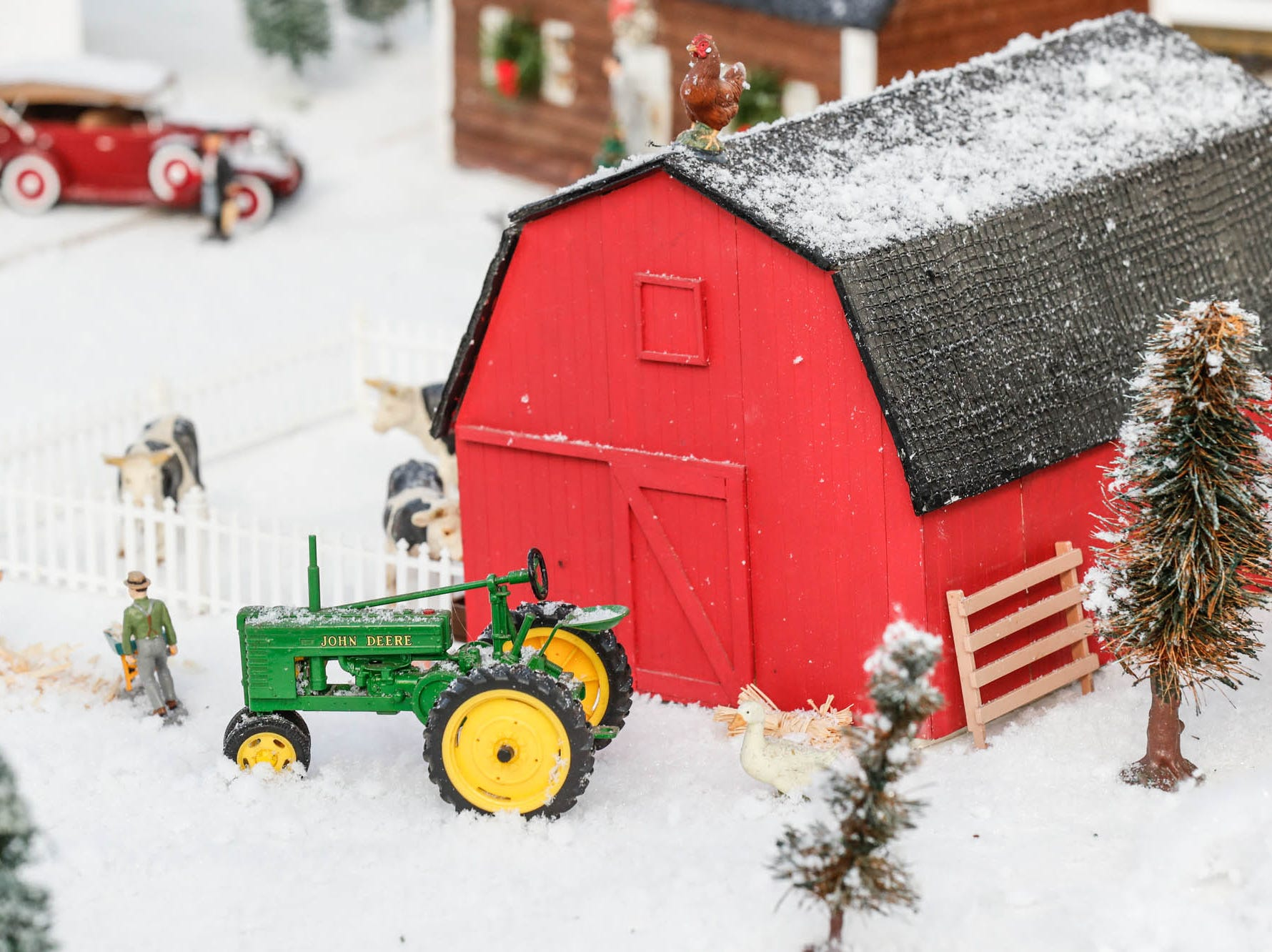 A town is ringed with train tracks in the Conservatory Crossing holiday display at the Garfield Park Conservatory on Saturday, Dec. 29, 2018.