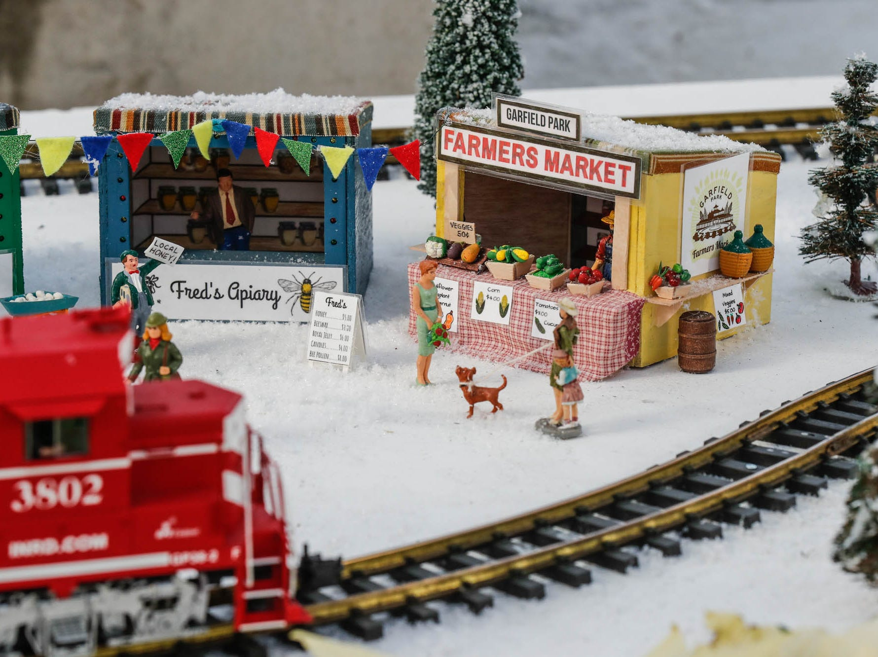 Garfield Park Farmers Market is depicted in the Conservatory Crossing holiday display at the Garfield Park Conservatory on Saturday, Dec. 29, 2018.