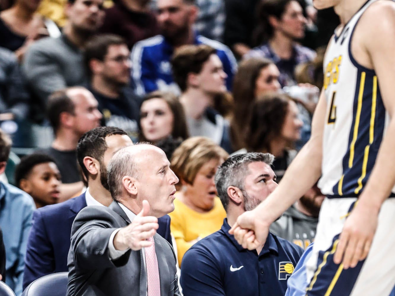 Pacers Assistant Coach Dan Burke side fives Indiana Pacer's forward Bojan Bogdanovic (44), on his way back to the bench during a game between the Indiana Pacers and the Detroit Pistons at at Bankers Life Fieldhouse in Indianapolis on Friday, Dec. 28, 2018.