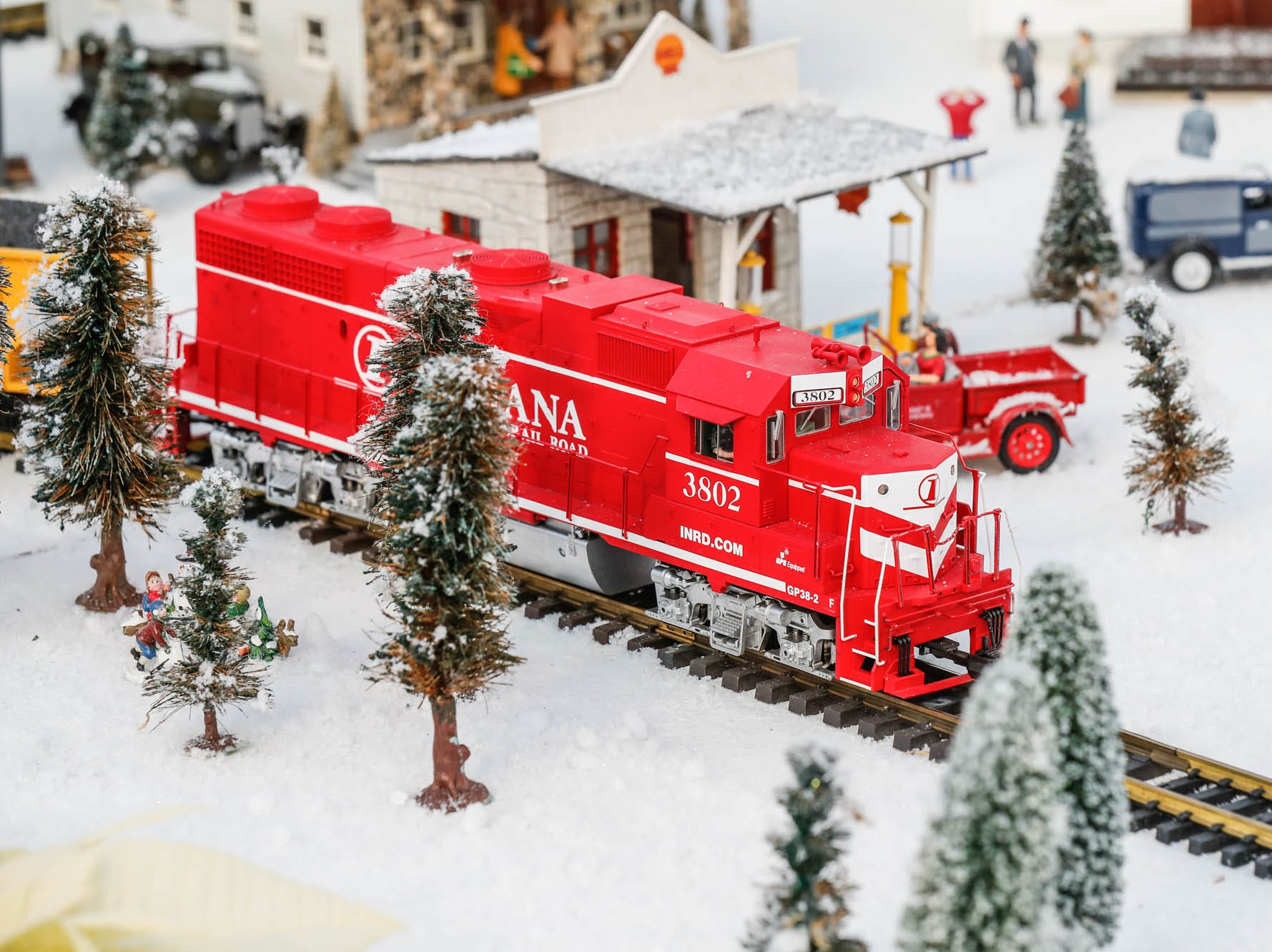 A train makes it's way through a tiny town in the Conservatory Crossing holiday display at the Garfield Park Conservatory on Saturday, Dec. 29, 2018.