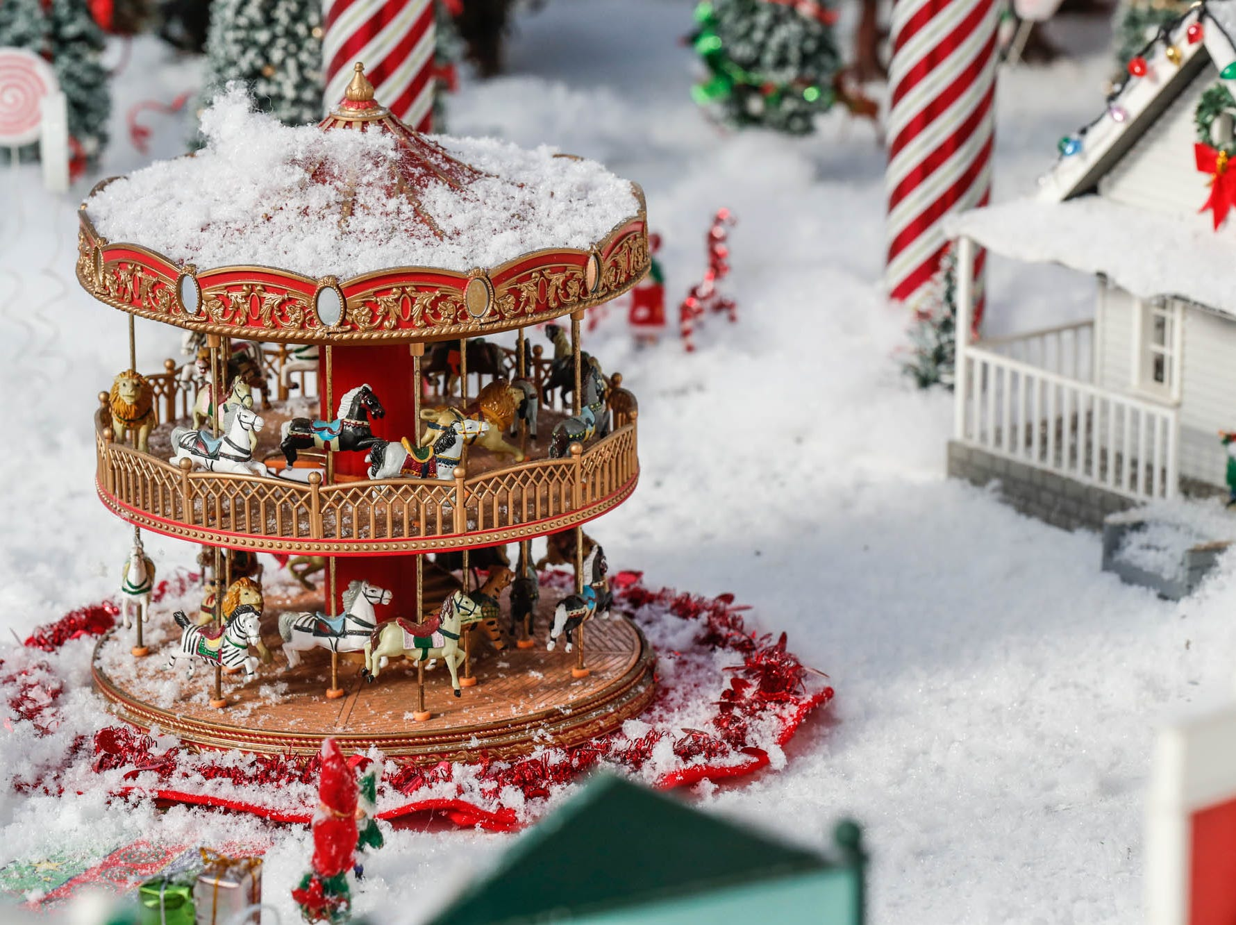 A double-decker carousel decorates the Conservatory Crossing holiday display at the Garfield Park Conservatory on Saturday, Dec. 29, 2018.