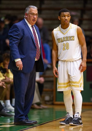 Warren Central High School head coach Criss Beyers talks with senior Isiah Moore (20) during a break in the second half of action against Valparaiso High School. New Castle High School hosted the annual Hall of Fame Classic tournament, Saturday, Dec. 29, 2018. Warren Central won 59-55.