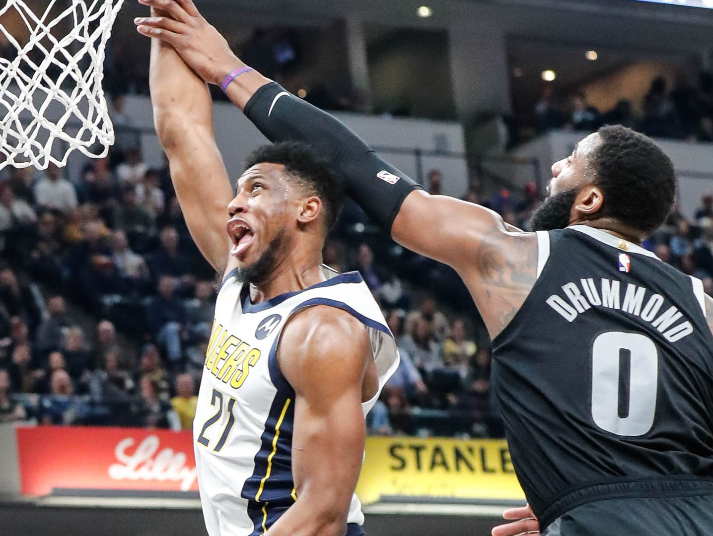 Detroit Piston's center Andre Drummond (0), attempts to block a shot by Indiana Pacer's forward Thaddeus Young (21), during a game between the Indiana Pacers and the Detroit Pistons at at Bankers Life Fieldhouse in Indianapolis on Friday, Dec. 28, 2018.