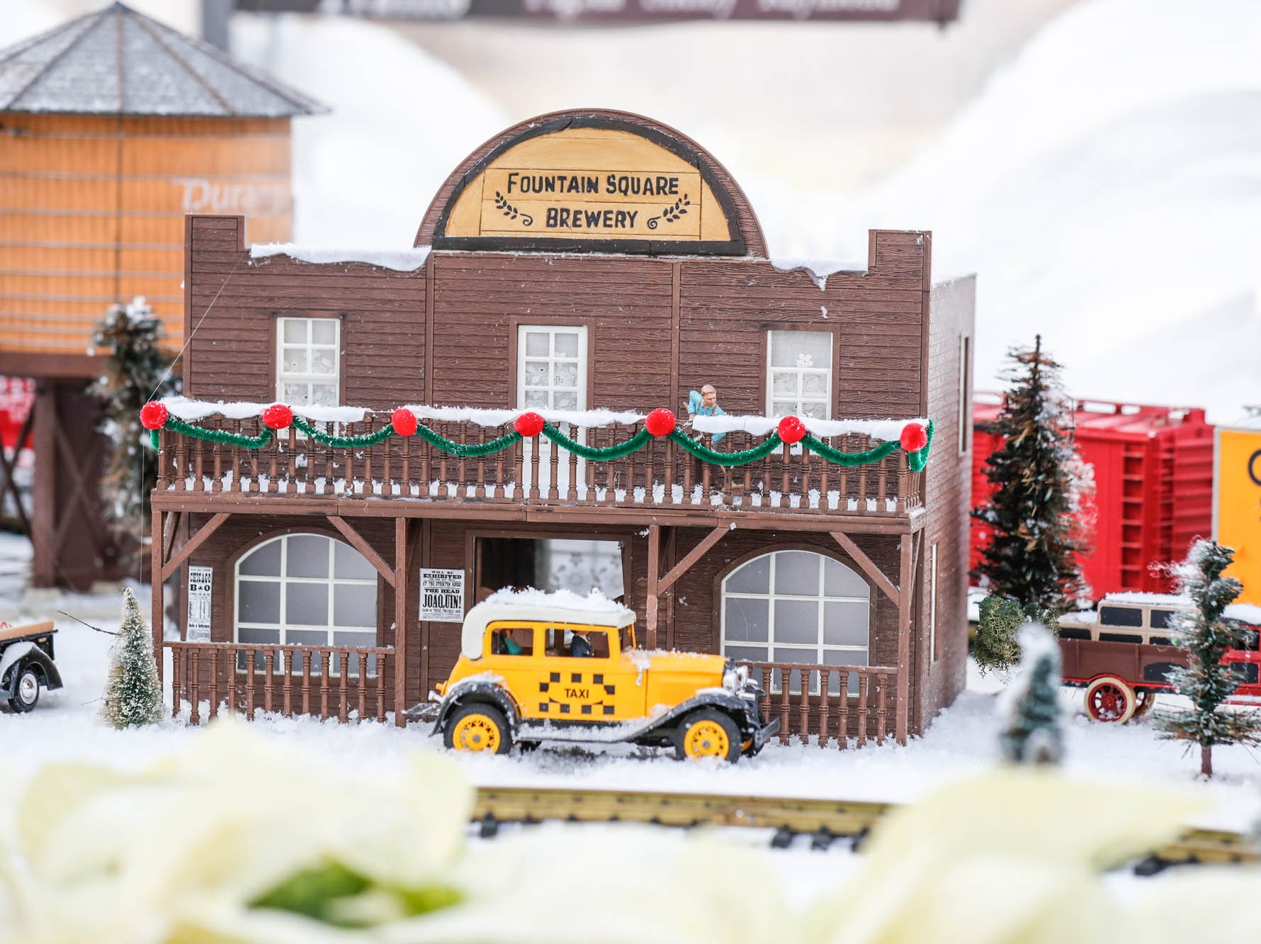 Fountain Square Brewery is depicted in the Conservatory Crossing holiday display at the Garfield Park Conservatory on Saturday, Dec. 29, 2018.