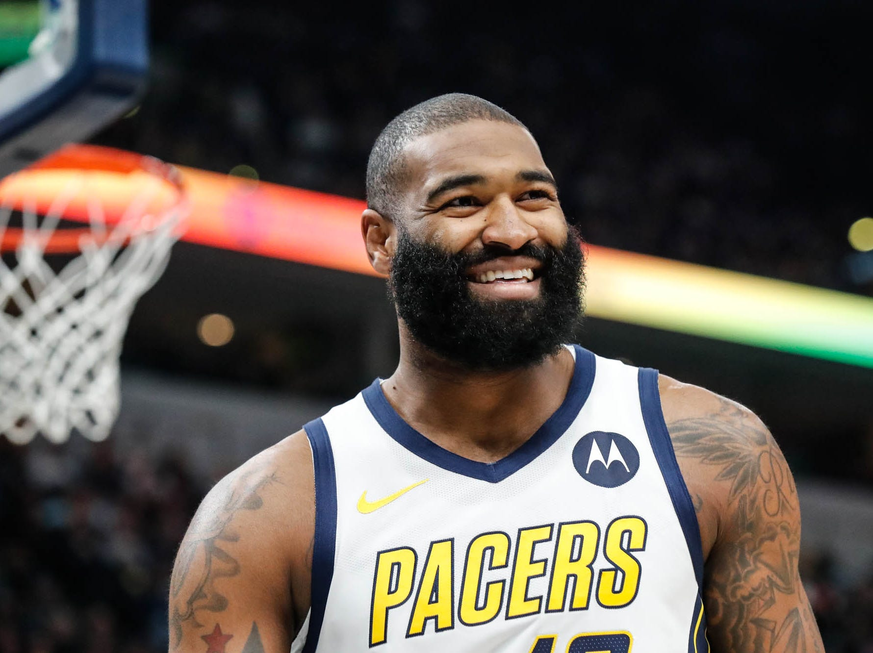 Indiana Pacer's center Kyle O'Quinn (10) laughs at teammate Indiana Pacer's guard Darren Collison (2) who was hit in the shins by an unexpected pass during a game between the Indiana Pacers and the Detroit Pistons at at Bankers Life Fieldhouse in Indianapolis on Friday, Dec. 28, 2018.