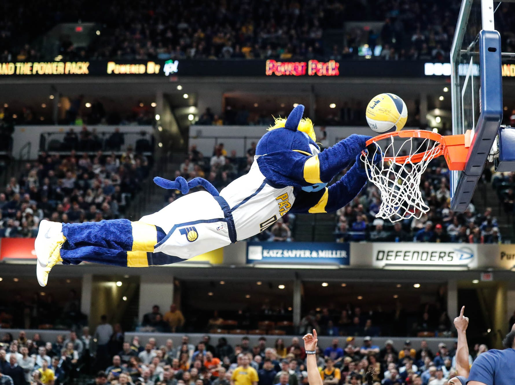 Pacers Mascot Boomer dunks the ball during a game between the Indiana Pacers and the Detroit Pistons at at Bankers Life Fieldhouse in Indianapolis on Friday, Dec. 28, 2018.