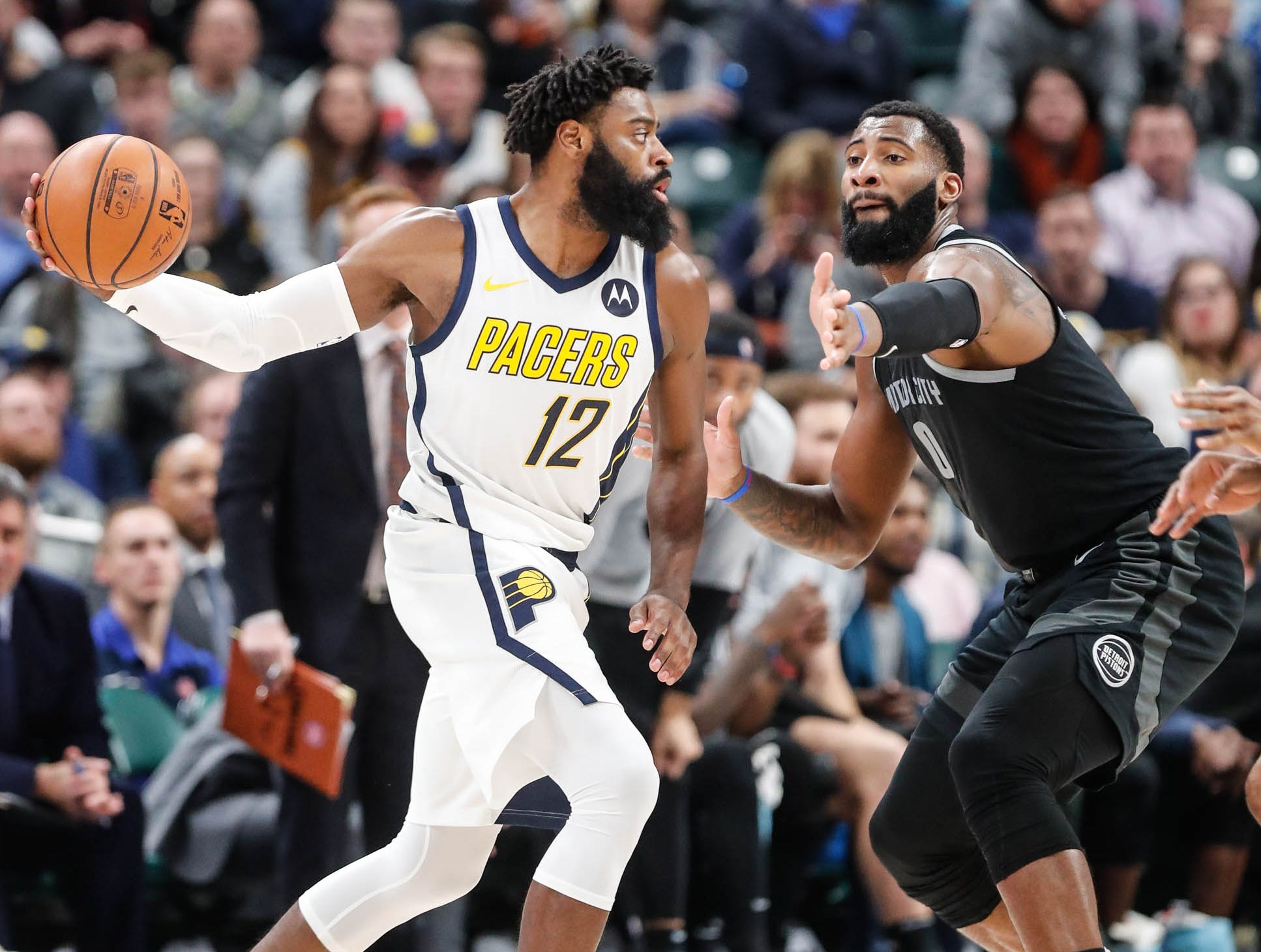 Indiana Pacer's guard Tyreke Evans (12), passes the ball around, Detroit Piston's center Andre Drummond (0), during a game between the Indiana Pacers and the Detroit Pistons at at Bankers Life Fieldhouse in Indianapolis on Friday, Dec. 28, 2018.