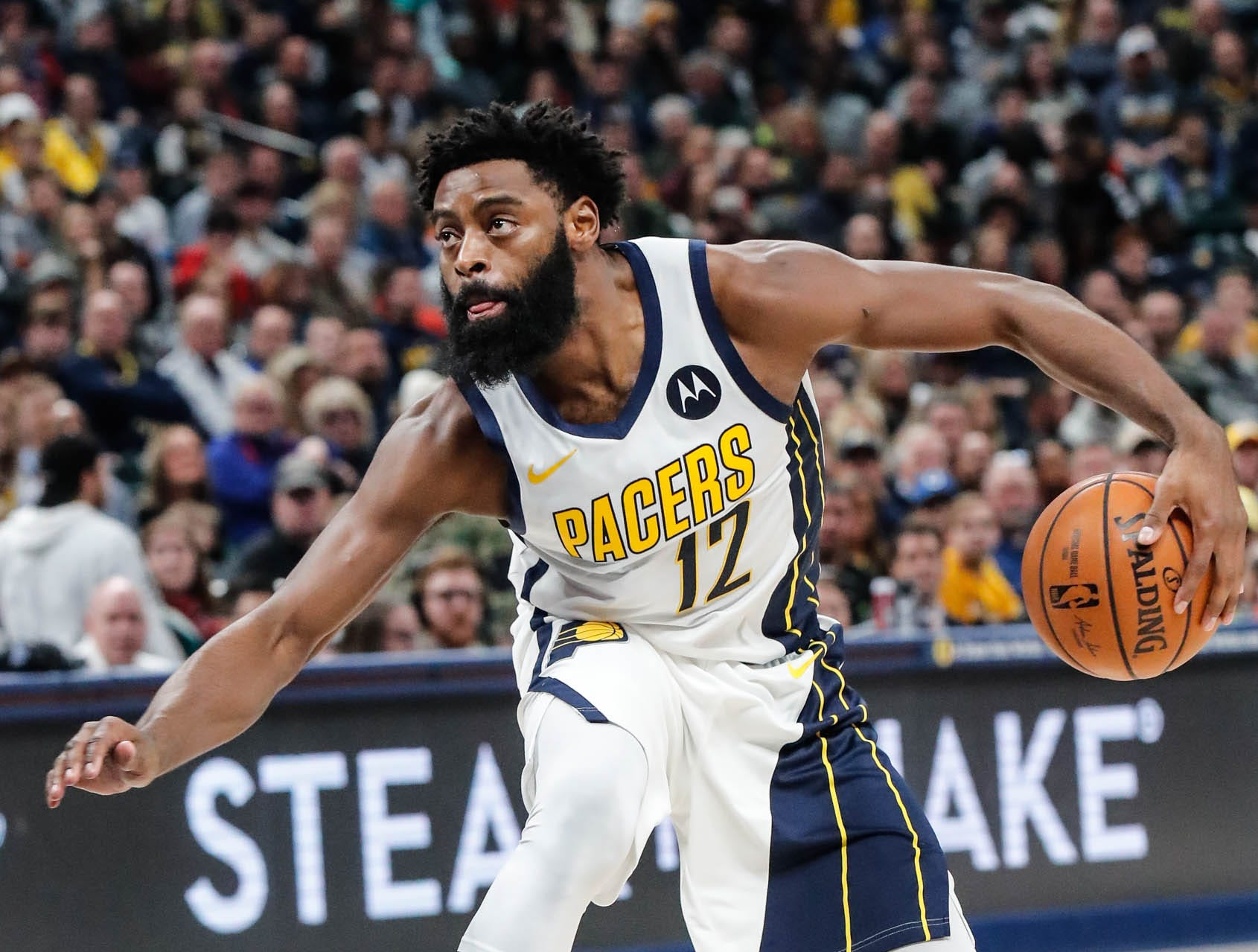 Indiana Pacer's guard Tyreke Evans (12) fakes out an opposing player during a game between the Indiana Pacers and the Detroit Pistons at at Bankers Life Fieldhouse in Indianapolis on Friday, Dec. 28, 2018.