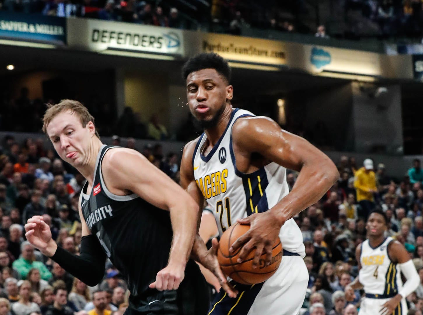Indiana Pacer's forward Thaddeus Young (21), and Detroit Piston's guard Luke Kennard (5), battle for the ball during a game between the Indiana Pacers and the Detroit Pistons at at Bankers Life Fieldhouse in Indianapolis on Friday, Dec. 28, 2018.
