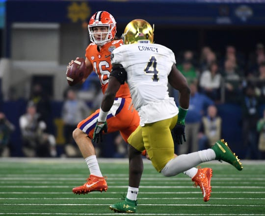 Notre Dame linebacker Te'von Coney (4) chased Clemson quarterback Trevor Lawrence (16) out of the pocket in the first half of the NCAA Cotton Bowl semi-final playoff football game.