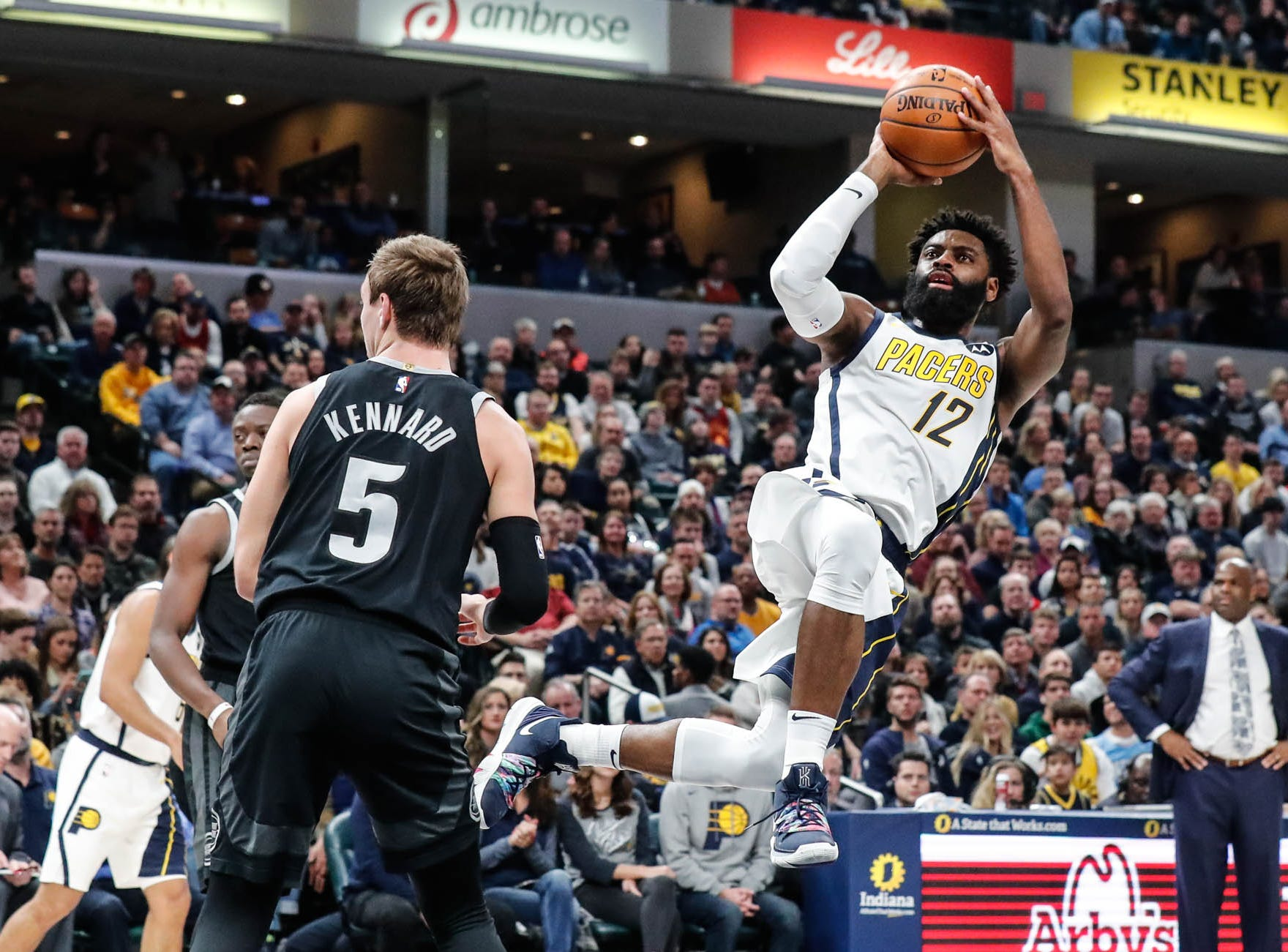 Indiana Pacer's guard Tyreke Evans (12) shoots a wacky jump shot as the whistle blows during a game between the Indiana Pacers and the Detroit Pistons at at Bankers Life Fieldhouse in Indianapolis on Friday, Dec. 28, 2018.
