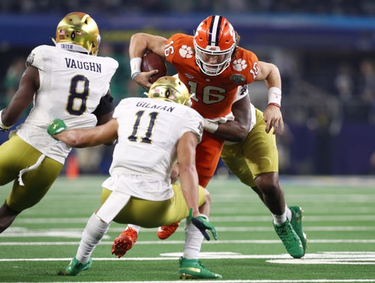 Alohi Gilman and Notre Dame cornerback Donte Vaughn (8) tackled  Clemson Tigers quarterback Trevor Lawrence in the first half of the 2018 Cotton Bowl. Notre Dame lost the game, 30-3. Afterward, Gilman assuredreporters that the Irish would be back.
