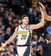 Indiana Pacer's forward Doug McDermott (20) high fives teammate after his dunk during a game between the Indiana Pacers and the Detroit Pistons at at Bankers Life Fieldhouse in Indianapolis on Friday, Dec. 28, 2018.
