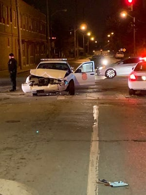 A police officer was injured after crashing into a car that had run a red light.