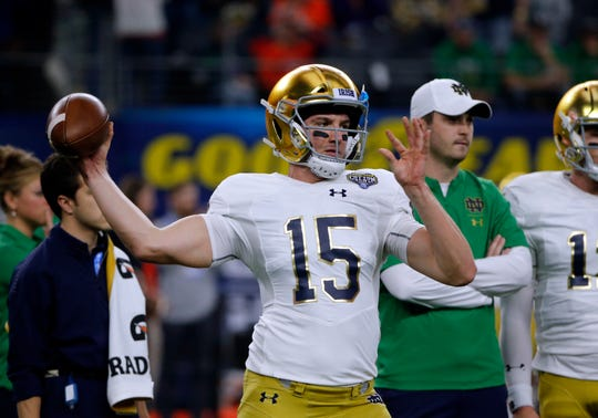 Notre Dame quarterback Phil Jurkovec (15) warms up before the NCAA Cotton Bowl semi-final playoff football game against Clemson o