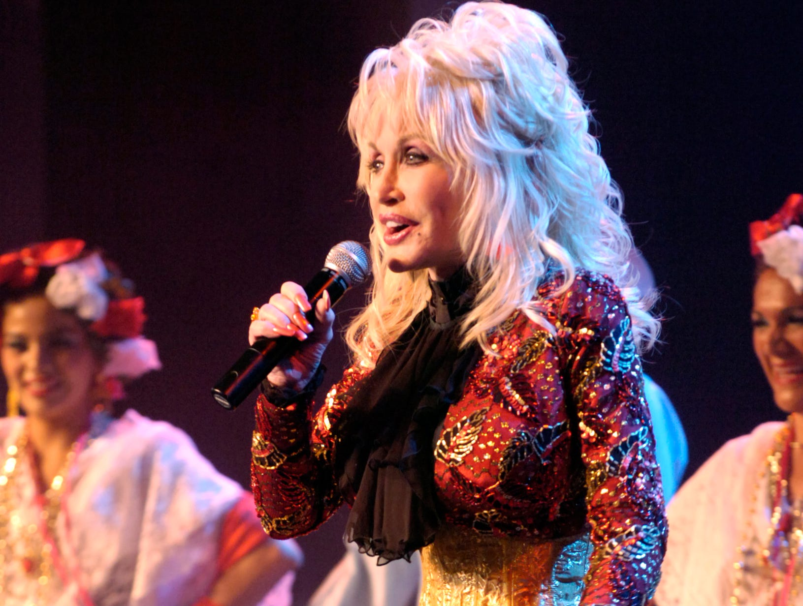 Dolly Parton dropped in during the performance of the Mexican Calpulli Dance Company Friday afternoon while she was at Dollywood for the opening of this year's new addition to.