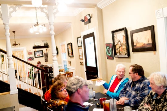 Patrons chat in the dining room at The Front Porch Restaurant in Powell, Tennessee on Saturday, December 29, 2018. For five years, owner Bart Elkins has worked to revive that experience of the front porch being used as the focus for family and friends.