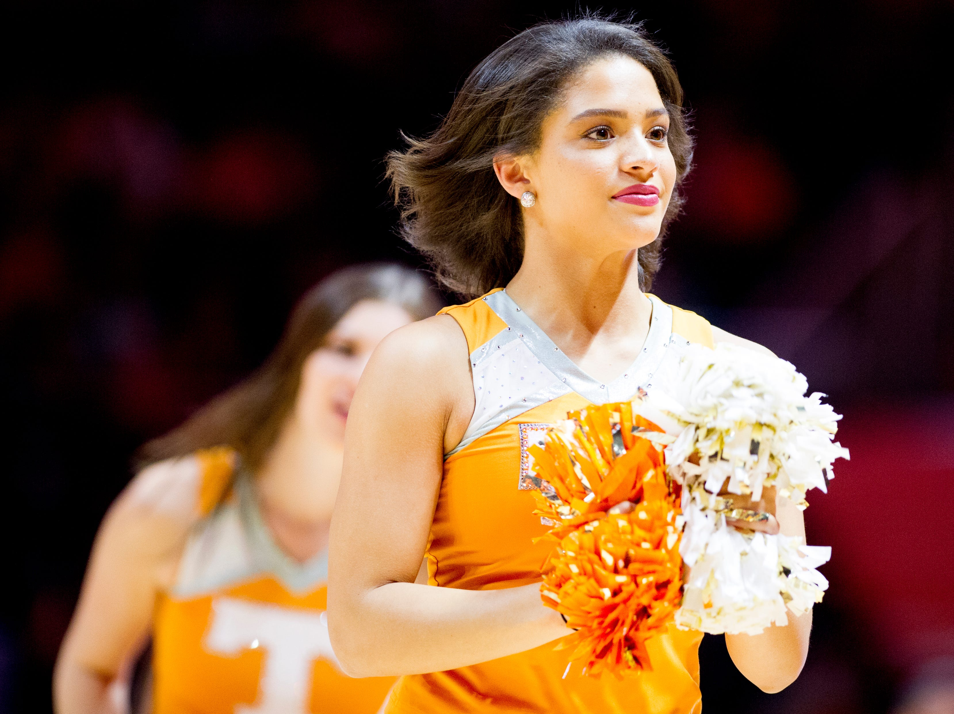 A Tennessee cheerleader runs down the court during a game between Tennessee and Tennessee Tech at Thompson-Boling Arena in Knoxville, Tennessee on Saturday, December 29, 2018.