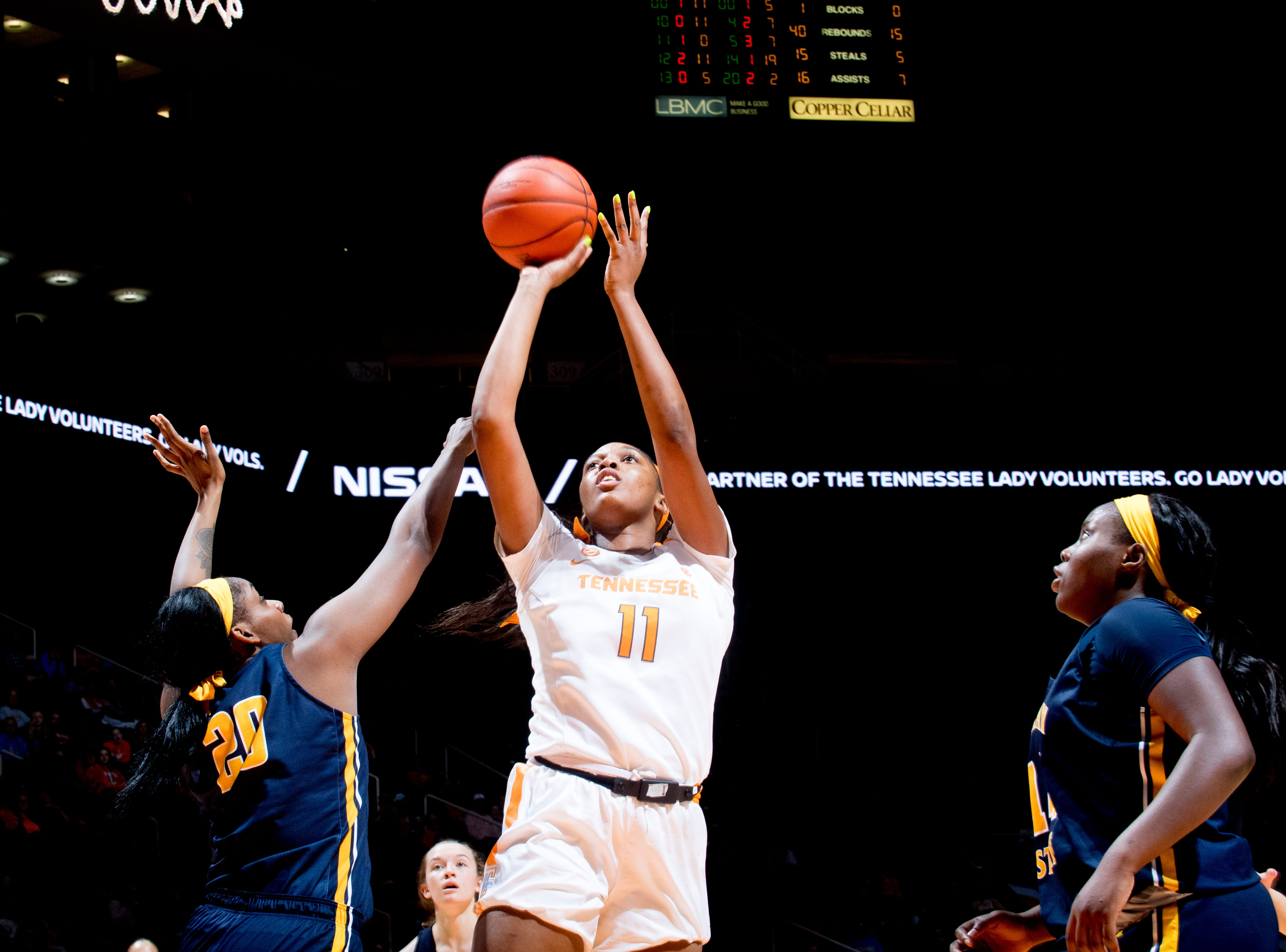 Tennessee center Kasiyahna Kushkituah (11) shoots past Murray State forward Cekeya Mack (20) during a game between the Tennessee Lady Vols and Murray State at Thompson-Boling Arena in Knoxville, Tennessee on Friday, December 28, 2018.