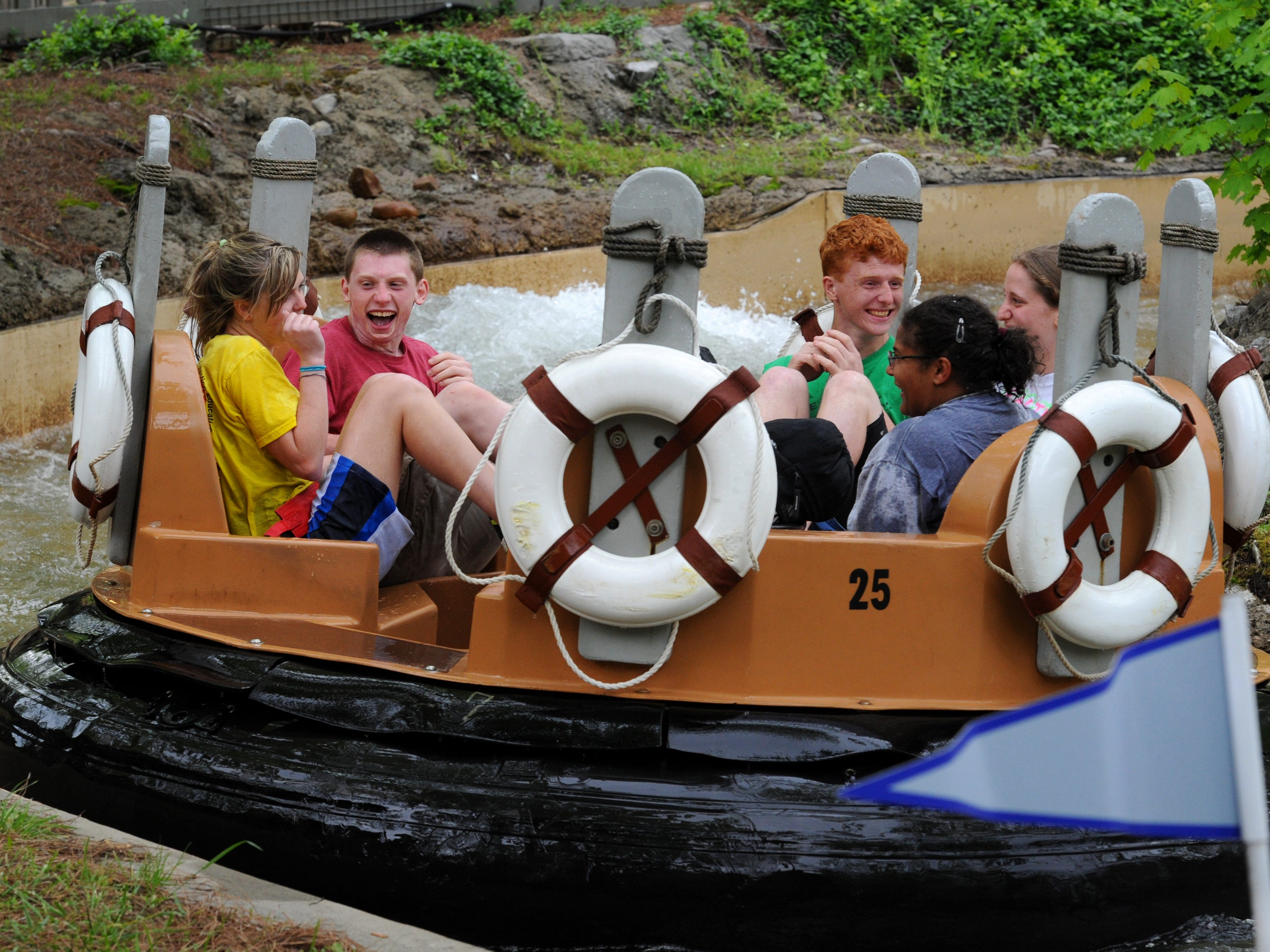 Kids enjoying the Smoky Mountain River Rampage at Dollywood during their 30th anniversary Wednesday, Apr. 22, 2015.