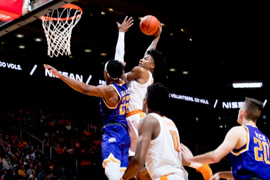 Tennessee guard Jordan Bowden (23) goes for a point as Tennessee Tech forward Courtney Alexander II (22) defends during a game between Tennessee and Tennessee Tech at Thompson-Boling Arena in Knoxville, Tennessee on Saturday, December 29, 2018.